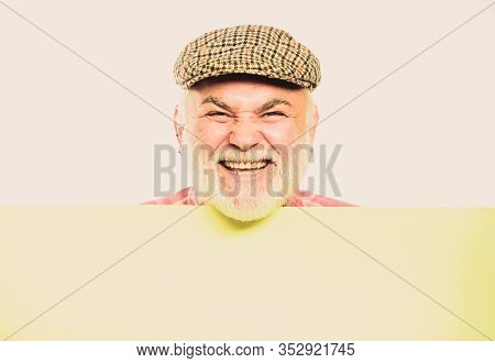 Announcement Concept. Senior Bearded Emotional Man Peek Out Of Banner Place Announcement. Event Anno