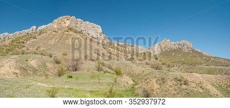 Panoramic Landscape With Taraktash Ridge In Crimean Mountains At Spring Season