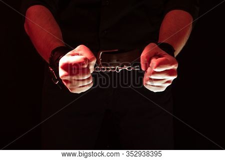 Mens Hands Chained In Leather Handcuffs For Bdsm Sex Behind His Back. Submission And Domination