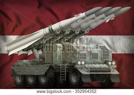 Tactical Short Range Ballistic Missile With Arctic Camouflage On The Latvia Flag Background. 3d Illu