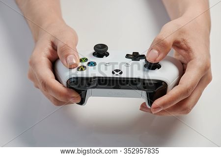 Gamer Holding Xbox Controller