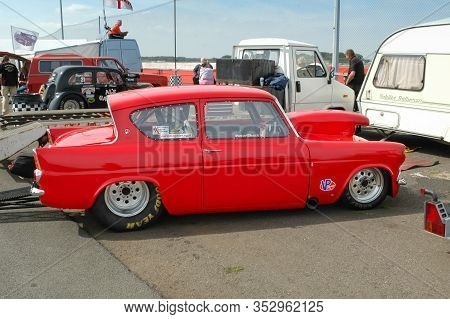 Northampton, Uk - September 9: Flame Red Vintage Ford Anglia Drag Car At A Motor Sport Event Near No