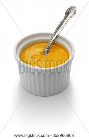 homemade rouille sauce in ramekin isolated on white background