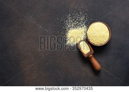 Corn Grits On A Dark Background. View From Above.