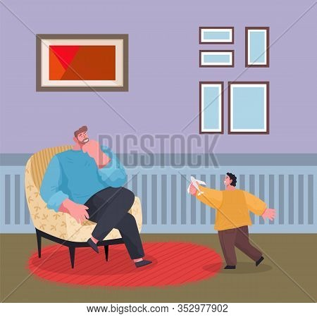 Father And Son Playing Active Games In Lounge. Man Sitting On Armchair, Kid Running Around Room. Fur