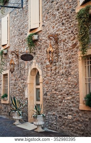 Vertical Picture Of Medieval Stone Narrow Street In Small Italian Town In Veneto With Vintage Lanter