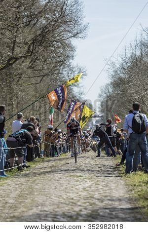 Wallers,france - April 12,2015: The Breakaway Approaching Through A Crowd Of Excited Spectators Duri