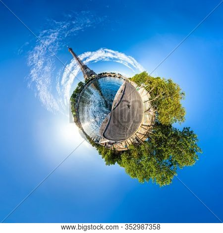 Miniature tiny planet of Scenic panorama of the Eiffel Tower and the riverside of Seine in Paris, France. 360 degree panoramic view