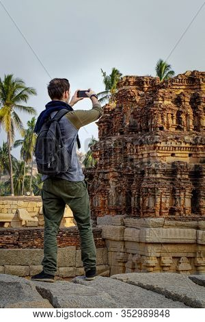 Guy Tourist Shoots A Photos Of Tourist Attractions. Beautiful View Of The Amazing Hampi's Ruins. Vit