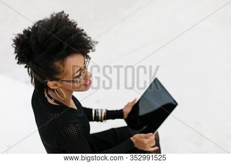 Stylish Businesswoman Using Digital Tablet For Tele Working Outside.