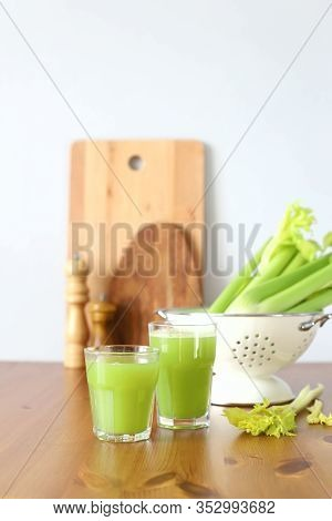 Celery Juice On The Kitchen Table. On A Grey Background
