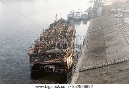 Old Burnt Cruise Ship Near Bank Of River Dnieper