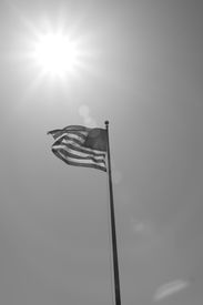 The American Flag with Sun Behind