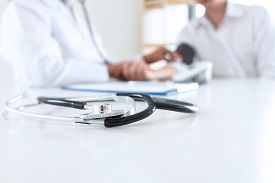 Close Up Of Stethoscope, Image Of Doctor Using Stethoscope Checking Measuring Arterial Blood Pressur