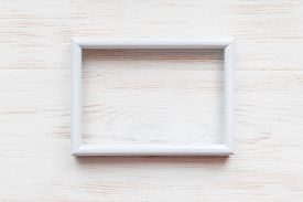 White Wooden Empty Frame For Painting, Picture Or Text On White Wooden Background. Wooden Blank Pict