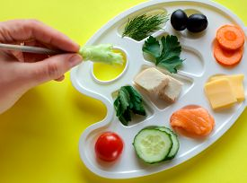 Palette With Tasty Colorful Vegetables, Fish And Greens, Creative Food Design, Funny And Healthy Mea