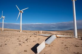 wind turbine in the desert with blue sky  background. wind mill farm in california desert