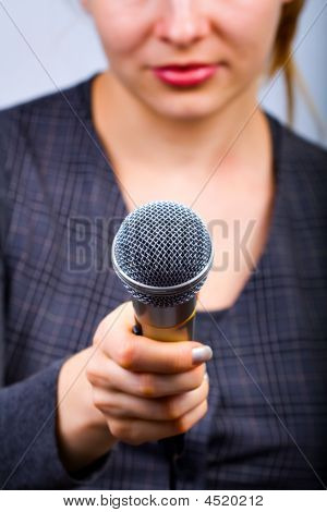 Reporter Taking Interview Or Opinion Poll