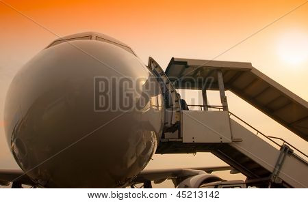Airplane Nose And Passanger Stairs