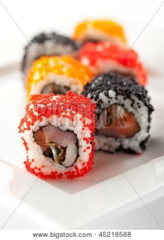 Japanese Cuisine - Sushi Roll with Tuna, Salmon, Conger and Flying Fish Roe