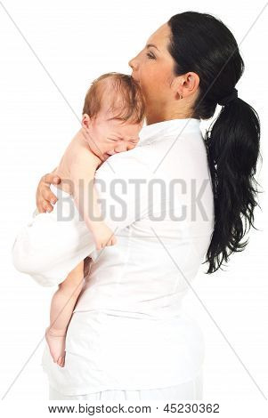 Mother Holding Crying Newborn