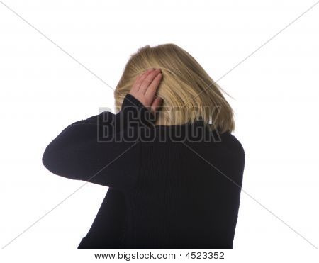 Child Turning Away And Covering Ears