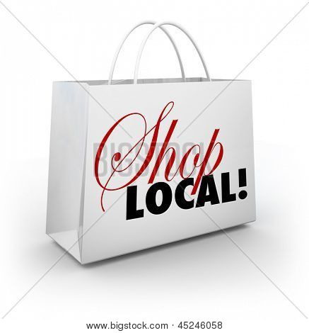 The words Shop Local on a white shopping bag encouraging you to support your local community or hometown by buying merchandise in your backyard and keeping money nearby poster