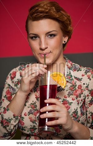 Attractive Young Woman Drinks Icetea In A Bar