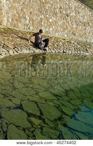 Man Reading Bible By Lake
