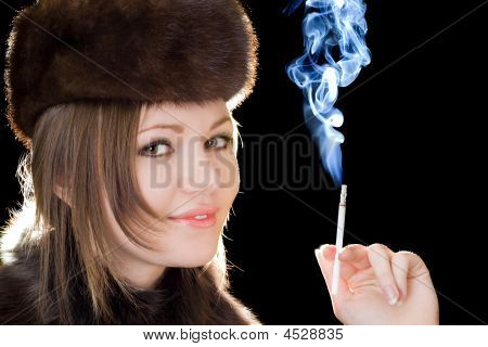 Portrait Of The Smiling Young Lady With A Cigarette