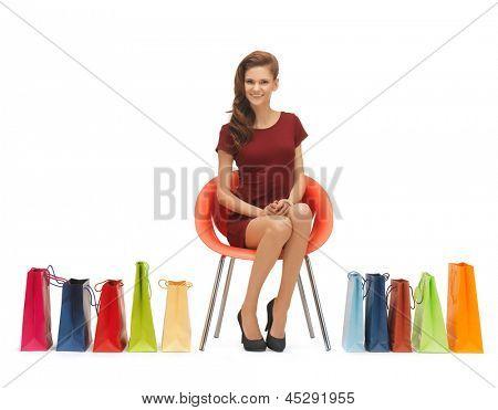 Bild der Frau in high Heels mit Einkaufstaschen.