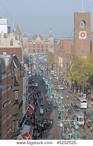 AMSTERDAM, THE NETHERLANDS, october 22: Busy Damrak, the Heart of Amsterdam, with the stockmarket and the central station in Amsterdam, the Netherlands, 2012.
