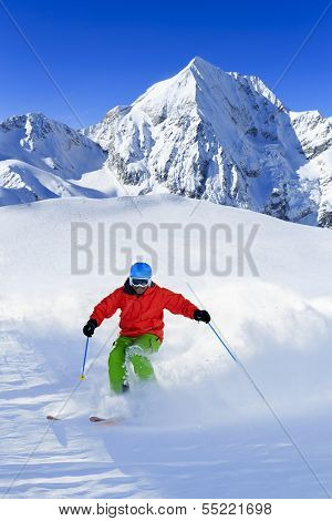 Ski, Freeride in fresh powder snow - man skiing downhill