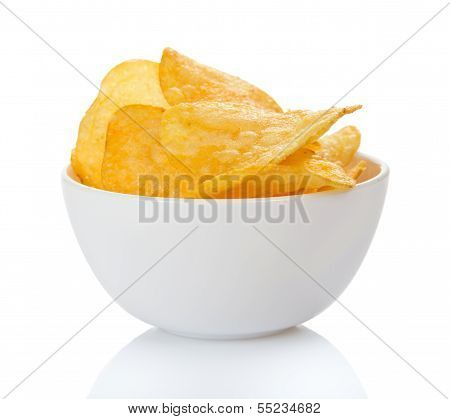 Appetizing golden chips in faience bowl