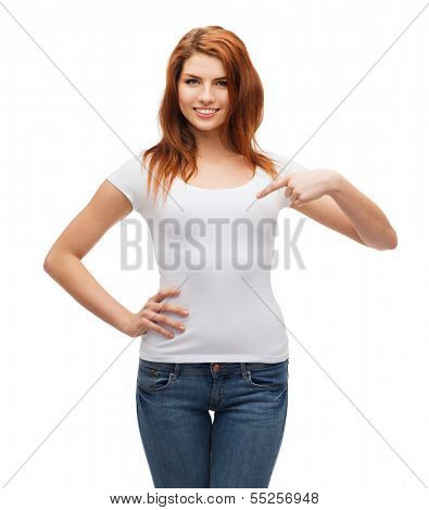 t-shirt design concept - smiling teenager in blank white t-shirt pointing her finger at herself
