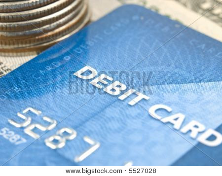 Narrow Focus Of Debit Card With Money