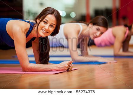Cute girls working out in a gym