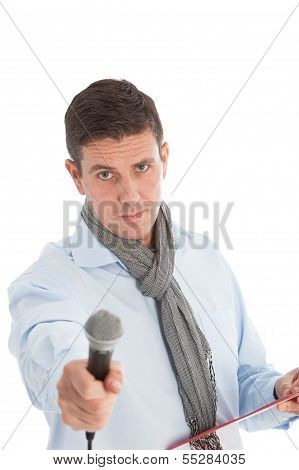 Expectant Man Holding Out A Microphone
