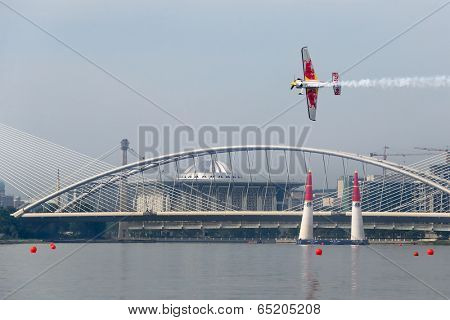 PUTRAJAYA, MALAYSIA - MAY 17, 2014: Kirby Chambliss from the USA in an Edge 540 V3 plane flies through the race course over Putrajaya lake at the Red Bull Air Race World Championship 2014.