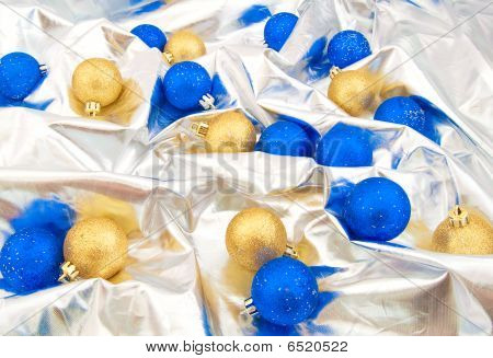Silver Background With A Set Of Blue And Gold Christmas Balls