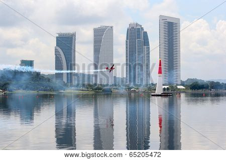 PUTRAJAYA, MALAYSIA - MAY 16, 2014: Pete McLeod from Canada flying an Edge 540 v3 takes to the skies of Putrajaya during a training session preparing for the Red Bull Air Race World Championship 2014.