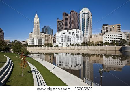 The Columbus, Ohio skyline reflected in the Scioto River.  Columbus is the capital of Ohio. poster
