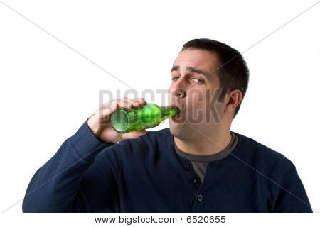 A young man drinking a bottle of beer isolated over a white background. poster