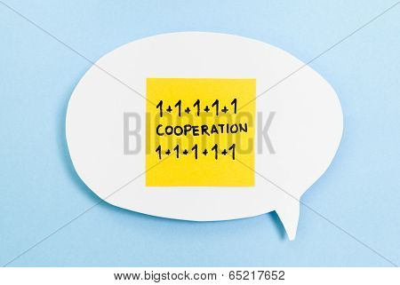 Cooperation Concept On Speech Bubble With Blue Background, one plus one.
