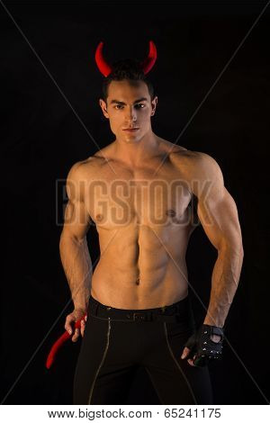 Shirtless Muscular Male Bodybuilder Dressed With Devil Costume