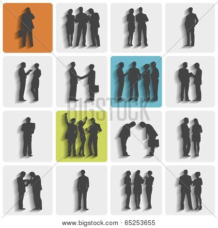 Silhouettes of business people standing and working.