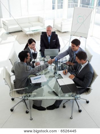 Businessmen Closing A Deal In A Meeting