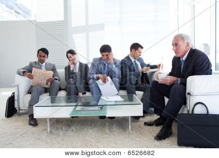 Business People Sitting And Waiting For A Job Interview