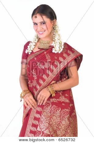 Indian teenage girl with rich red sari
