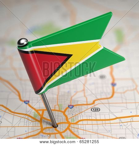 Guyana Small Flag on a Map Background.
